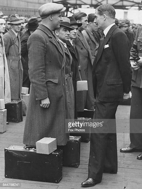 Secretary of State Anthony Eden talking to a group of Newfoundlanders new volunteers for the Royal Artillery during World War Two at a port on the...