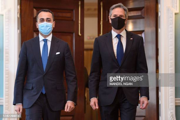 Secretary of State Antony Blinken and Italy's Foreign Minister Luigi Di Maio make their way into the Treaty Room to pose for photos ahead of a...