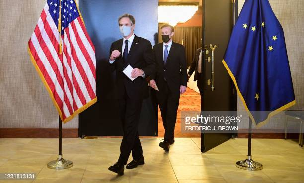 Secretary of State Antony Blinken and National Security Advisor Jake Sullivan exit the ballroom from the closed-door morning session of talks between...
