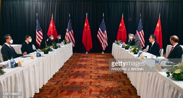 Secretary of State Antony Blinken , joined by National Security Advisor Jake Sullivan , speaks while facing Yang Jiechi , director of the Central...