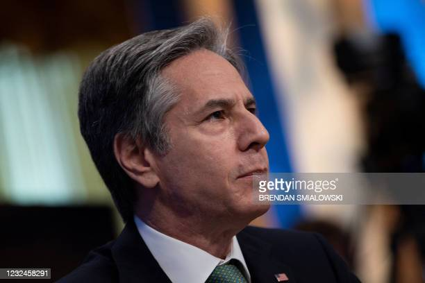 Secretary of State Antony Blinken listens during a climate change virtual summit from the East Room of the White House campus April 22 in Washington,...