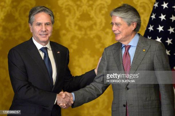 Secretary of State Antony Blinken shakes hands with Ecuador's President Guillermo Lasso during a meeting at Carondelet presidential palace in Quito,...