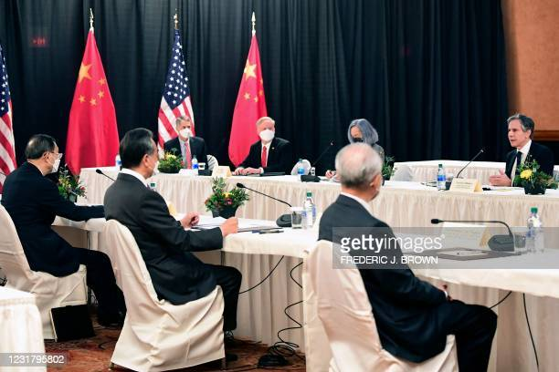 Secretary of State Antony Blinken speaks while facing Yang Jiechi , director of the Central Foreign Affairs Commission Office, and Wang Yi , China's...
