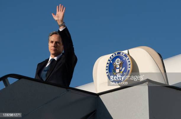 Secretary of State Antony Blinken waves as he boards his airplane prior to departing Copenhagen Airport in Denmark, May 17 as he travels to Iceland,...