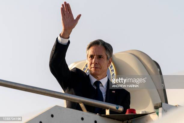 Secretary of State Antony Blinken waves before boarding his plane at Ciampino Airport in Rome to travel to Bari, Italy, on June 28 as part of...