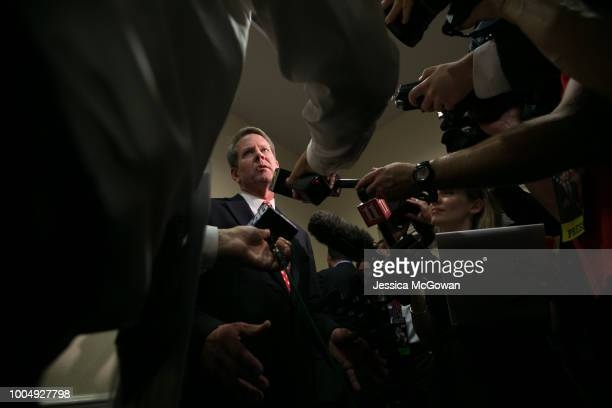 Secretary of State Brian Kemp addresses the media after he declares victory during an election watch party on July 24, 2018 in Athens, Georgia. Kemp...