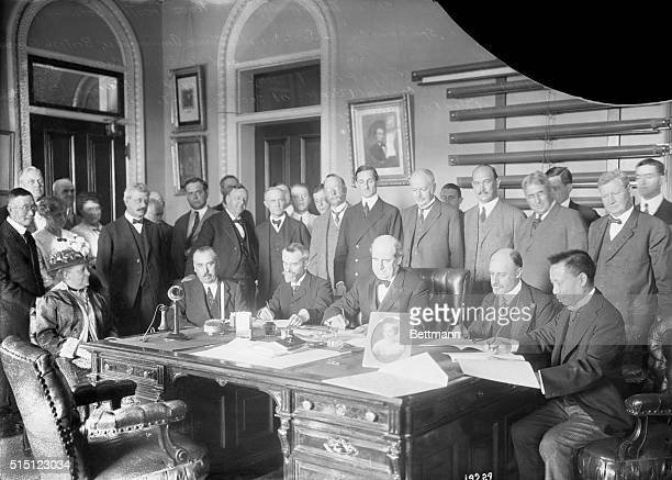 Secretary of State Bryan signing peace treaties between the United States, France, Great Britain, Spain and China. In notifying Russia, Germany,...
