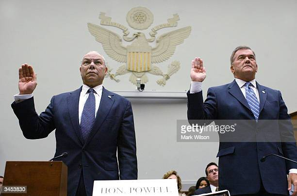 Secretary of State Colin Powell and Homeland Security Director Tom Ridge are sworn in before testifing to a the House Judiciary Committee on Capitol...