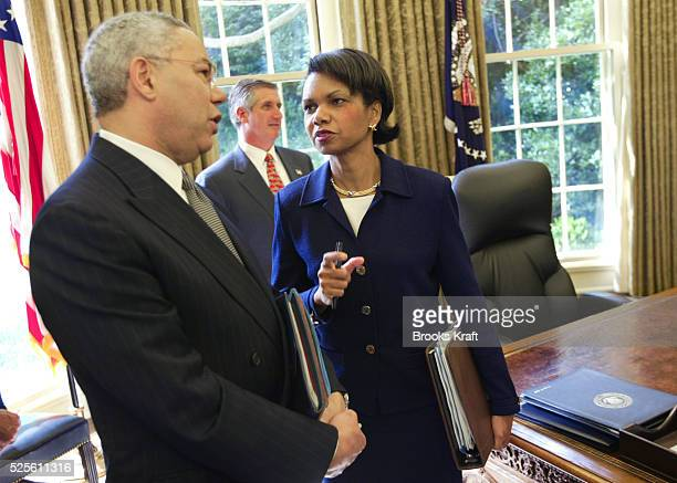 Secretary of State Colin Powell and National Security Adviser Condoleezza Rice talk in the Oval Office of the White House after a meeting between...