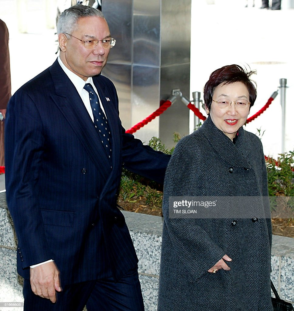 US Secretary of State Colin Powell (L) escorts Jap