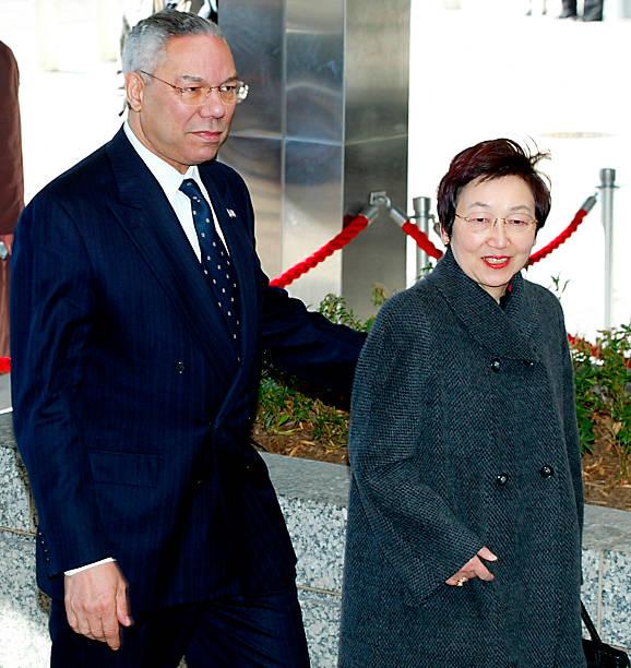 US Secretary of State Colin Powell (L) escorts Jap
