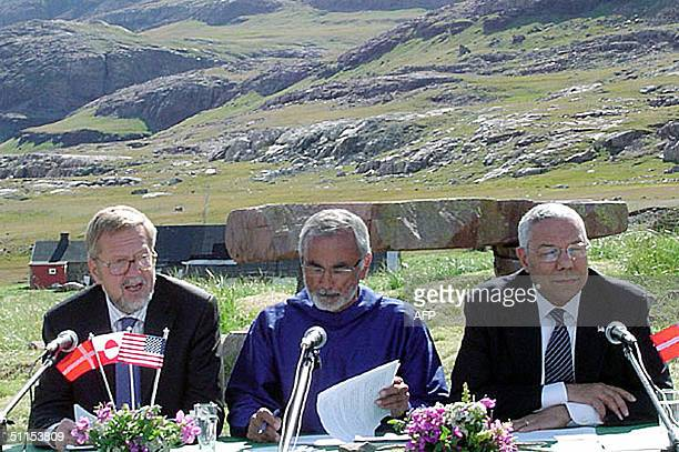 Secretary of State Colin Powell , Greenland Deputy Premier Josef Motzfeldt , and Danish Foreign Minister Per Stig Moeller sign an agreement in...
