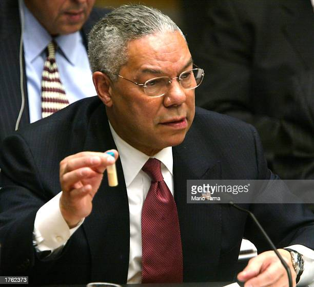 S Secretary of State Colin Powell holds a vial representing the small amount of Anthrax that closed the US Senate last year during his address to the...