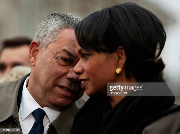 Secretary of State Colin Powell leans over to speak to National Security Advisor Condoleezza Rice