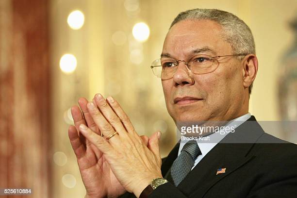 Secretary of State Colin Powell listens as President Bush speaks on trade promotion authority at the Department of State