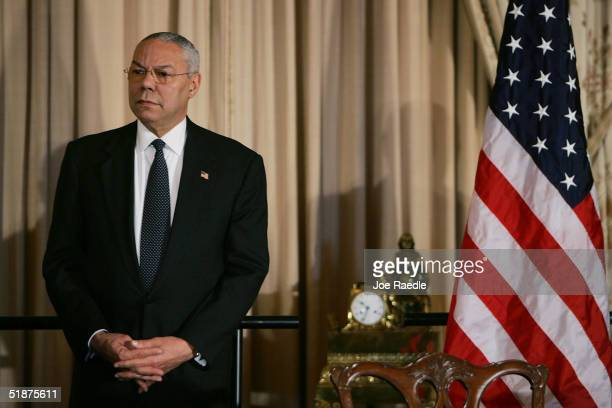 S Secretary of State Colin Powell listens to Iraqi Minister of Finance Dr Adil Abd alMahdi speak before a signing of a 100 percent debt forgiveness...