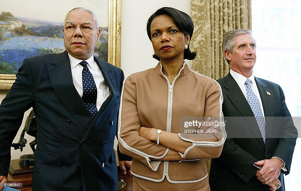 US Secretary of State Colin Powell (L), National Security Advisor Condoleezza Rice (C) and White House Chief of Staff Andrew Card (R) look on as US President George W. Bush meets with Chilean President Ricardo Lagos in the Oval Office of the White House 19 July 2004 in Washington, DC. Bush and Lago were to discuss democracy and trade in Latin American, notably on the free trade agreement between the two countries that took effect 01 January. Since the deal, Chile's exports to the United States have jumped by 13 percent, while US exports to Chile rose 13 percent. AFP Photo/Stephen JAFFE