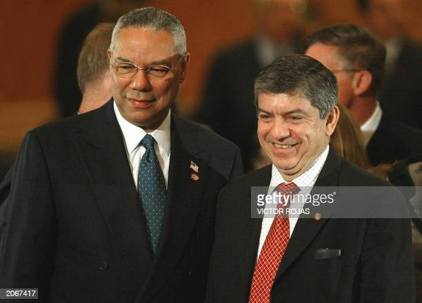 US Secretary of State Colin Powell poses with Organization of American States Secretary General Cesar Gaviria June 2003 in Santiago Chile Powell was...