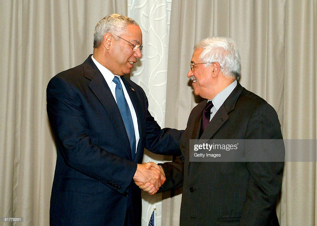U.S. Secretary of State Colin Powell (L) shakes a hand with Palestine Liberation Organisation (PLO) chief Mahmoud Abbas (R) November 22, 2004 in the West Bank town of Jericho. Powell won an Israeli pledge on Monday to allow Palestinians freedom of movement to enable them to hold an election for Yasser Arafat's successor, which is planned to take place on January 9, 2005.