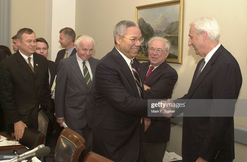 Secretary of State, Colin Powell, shakes hands with Rep. John Cooksey, R-La., as he enters the U.S. Capitol to give congress information on recent developments in the fight against terror.