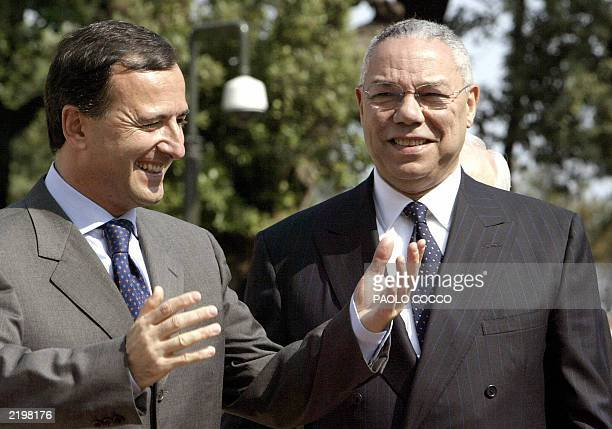 US Secretary of State Colin Powell smiles as Italian Foreign Minister Franco Frattini welcomes him prior a meeting in Romem 02 June 2003 Powell on...