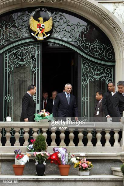 Secretary of State Colin Powell walks out of the Indonesian Embassy after signing the condolence book for those thousands who have lost their lives...