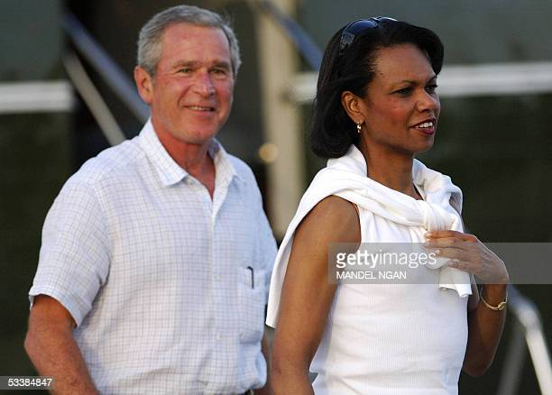 Secretary of State Condoleezza Rice and US President George W Bush walk from Marine One as they make their way to the Little League Baseball...
