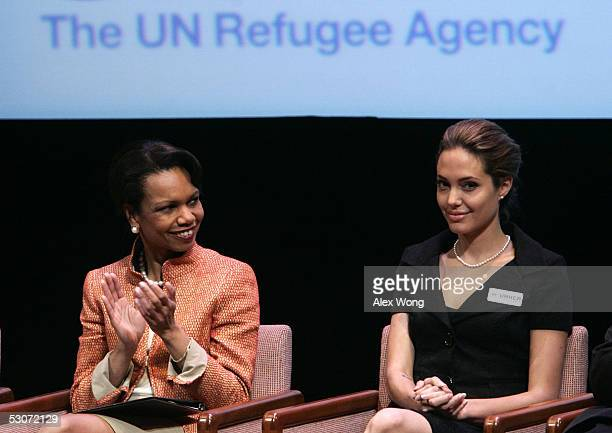 Secretary of State Condoleezza Rice applauds as actress and Goodwill Ambassador for the United Nations High Commissioner for Refugees Angelina Jolie...