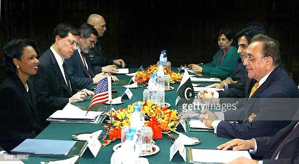 Secretary of State Condoleezza Rice front left smiles at her Pakistani counterpart Khurshid Kasuri front right during a meeting in Islamabad Pakistan...