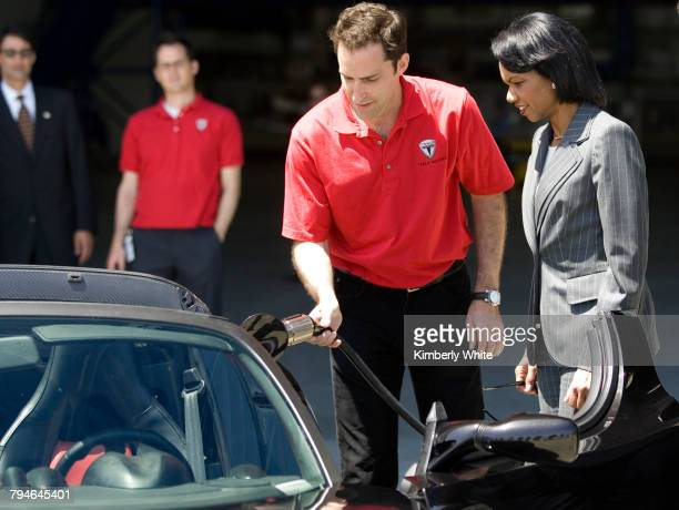 US Secretary of State Condoleezza Rice is shown by Tesla sales manager Tom O'Leary how the Tesla Roadster is charged at the Ames Research Center NASA...