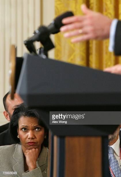 Secretary of State Condoleezza Rice listens during a joint news conference with U.S. President George W. Bush and Afghan President Hamid Karzai at...
