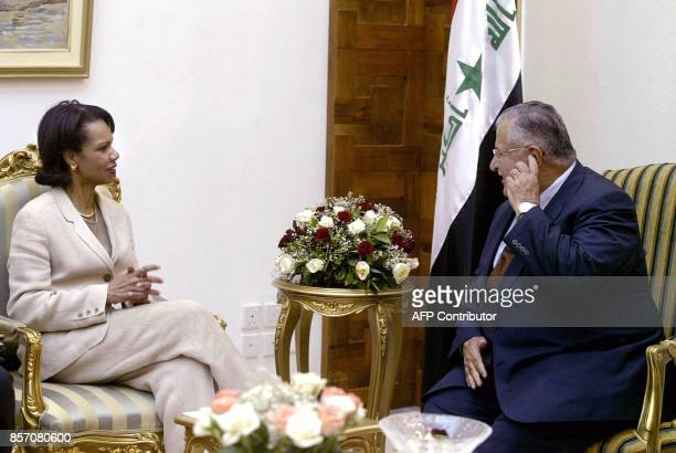US Secretary of State Condoleezza Rice listens on as Iraqi President Jalal Talabani gestures during a meeting at his home in Baghdad 15 May 2005 Rice...