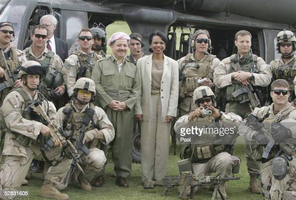 S Secretary of State Condoleezza Rice poses with Kurdish leader Massoud Barzani and US Army soldiers on May 15 2005 in the northern city of Arbil...