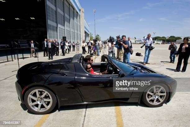 US Secretary of State Condoleezza Rice rides in a Telsa Motors Roadster with with Tesla sales manager Tom O'Leary at the Ames Research Center NASA in...