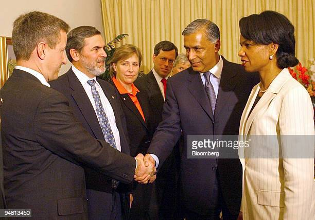 S Secretary of State Condoleezza Rice right introduces members of her delegation to Pakistani Prime Minister Shaukat Aziz second from right in...