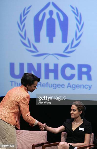 S Secretary of State Condoleezza Rice shakes hands with actress and Goodwill Ambassador for the United Nations High Commissioner for Refugees...