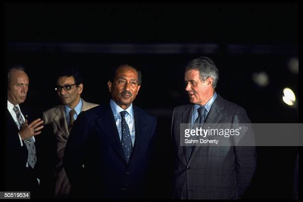 US Secretary of State Cyrus Vance standing with Egyptian President as US Envoy to the Middle East Alfred Atherton stands in background at Mamoura...