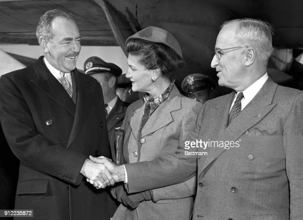 Secretary of State, Dean Acheson, is greeted by Mrs. Acheson and President Truman as he arrived at Washington Airport from Europe.