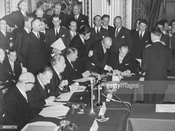 US Secretary of State Dean Acheson signs a protocol defining relations between the European Defence Community and NATO at the Quai d'Orsay in Paris...