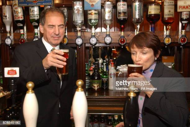 Secretary of State for Culture Media and Sport Tessa Jowell and Licensing Minister Kim Howells enjoy a pint of Tetley's bitter in the Red Lion pub...
