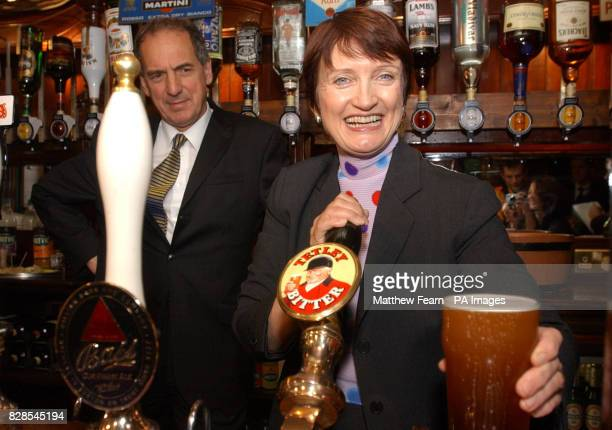 Secretary of State for Culture Media and Sport Tessa Jowell pulls a pint of Tetley's bitter watched by Licensing Minister Kim Howells in the Red Lion...