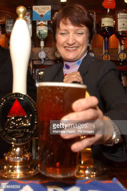 Secretary of State for Culture Media and Sport Tessa Jowell pulls a pint of Tetley's bitter in the Red Lion pub London Jowell is formally launching a...
