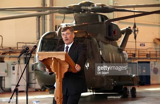 Secretary of State for Defence Bob Ainsworth delivers a speech in front of a Merlin helicopter to troops serving with the Puma and Merlin helicopter...