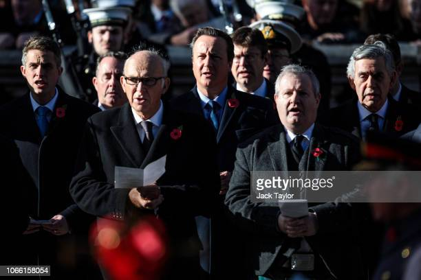 Secretary of State for Defence Gavin Williamson and Former British Prime Ministers David Cameron and Gordon Brown sing a hymn as they stand behind...