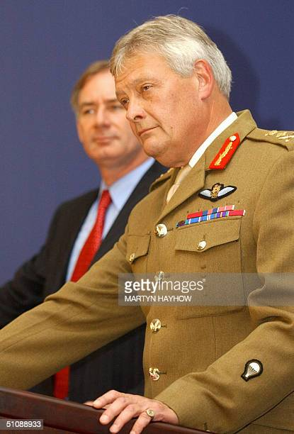 Secretary of State for Defence Geoff Hoon listens to General Sir Mike Walker at the Ministry of Defence in London after Hoon had announced his...