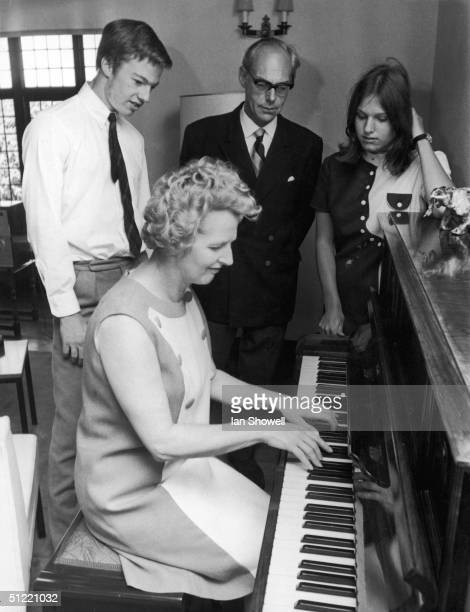 Secretary of State for Education and Science and future British Prime Minister Margaret Thatcher plays the piano for husband Denis and their...