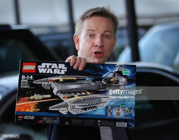 Secretary of State for Education Michael Gove holds up a Star Wars Lego toy as he arrives at the Conservative Party Conference on October 5 2010 in...