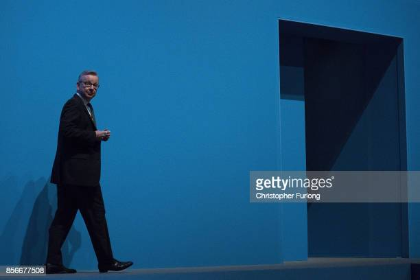 Secretary of State for Environment, Food and Rural Affairs, Michael Gove leaves the stage after delivering his keynote speech on day two of the...