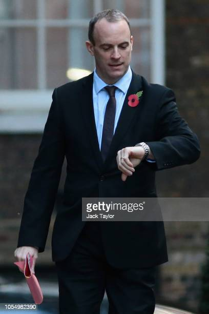 Secretary of State for Exiting the European Union Dominic Raab checks the time on his watch as he arrives for a Cabinet meeting at 10 Downing Street...