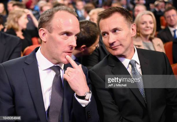 Secretary of State for Exiting the European Union Dominic Raab speaks to Secretary of State for Foreign and Commonwealth Affairs Jeremy Hunt as they...